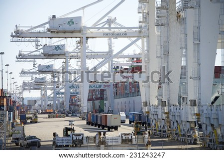 OAKLAND, CA - NOVEMBER 17, 2014: Port of Oakland, Zones 3 and 4. A container crane can move approximately 30 containers an hour. Several cranes are working on each vessel, expediting the work flow. - stock photo