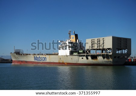 OAKLAND - OCTOBER 12: Matson shipping boat is unloaded by cranes in Oakland Harbor. Fourth busiest container port in the country, major economic engine in Bay Area. Oakland California October 12 2015. - stock photo
