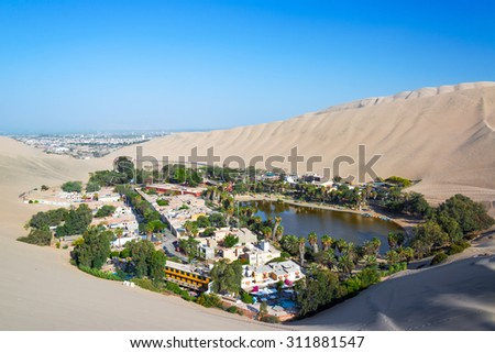 Oasis of Huacachina with Ica, Peru in the background - stock photo