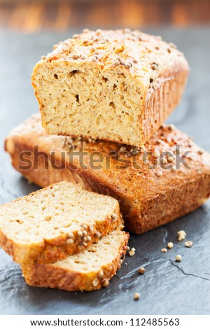 oat bran bread  with coriander - stock photo