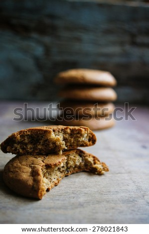 Oat flake cookies on the old wooden table - stock photo