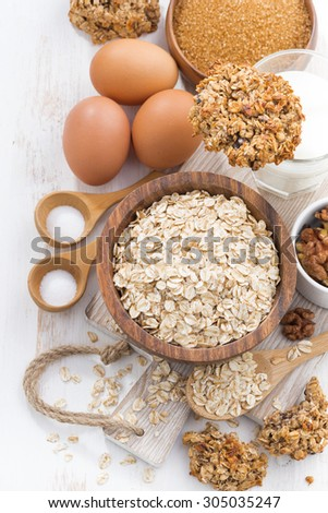 oat flakes and ingredients for making cookies, top view, vertical, close-up - stock photo