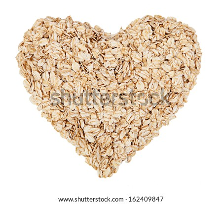Oat flakes lying in a heart-shaped - stock photo