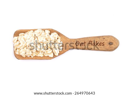 Oat flakes on shovel - stock photo