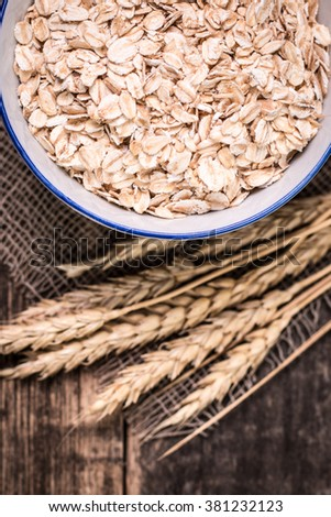 oat flakes on wooden table.healthy food concept. - stock photo