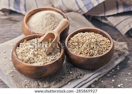Oat flakes, seeds and bran in bowls - stock photo