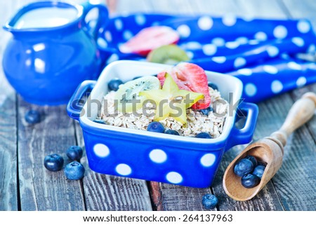 oat flakes with berries and fruits - stock photo