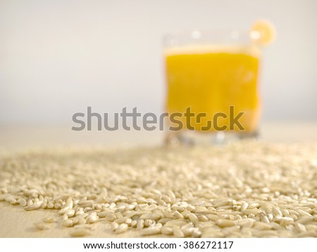 oat seeds and carrot smoothie - stock photo
