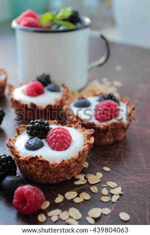 Oat tarts cookies with light yogurt and berries fruits - stock photo