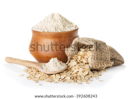 oat  wholegrain flour in bowl and  spoon,   bag with oat flakes isolated on a white background closeup - stock photo