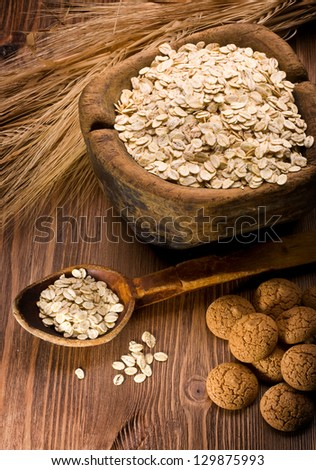 oatmeal and cookies on a wooden background - stock photo