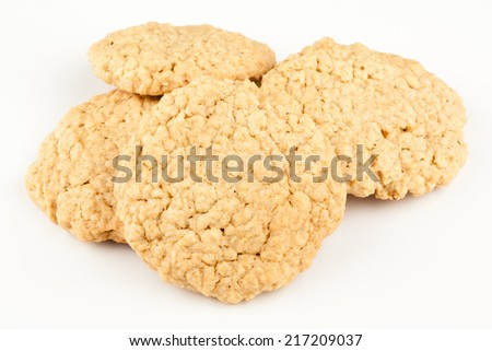 Oatmeal Cookies - A set of fresh, homemade oatmeal cookies set on a white background. - stock photo