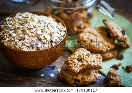 Oatmeal cookies with raisins on wooden background,vintage - stock photo