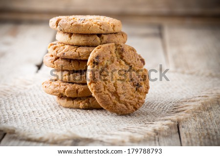 Oatmeal cookies with wooden background. - stock photo