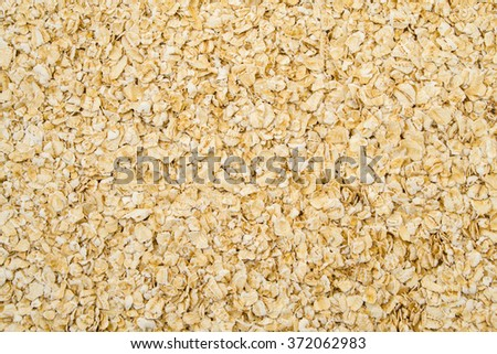 Oatmeal flakes close up shot as background. - stock photo