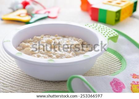 Oatmeal porridge for children nutrition - stock photo