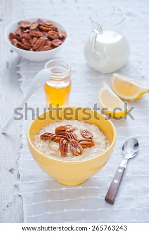 Oatmeal Porridge with Honey and nuts - stock photo