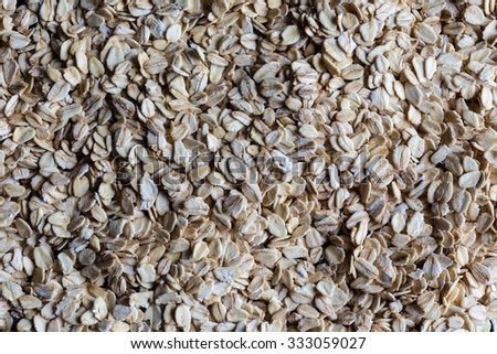 Oatmeal rolled oats grains spread evenly on surface directly from above - stock photo