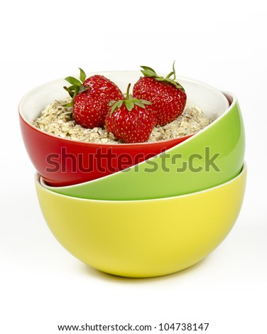 oatmeal with fresh strawberries - stock photo