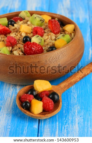 Oatmeal with fruits on table close-up - stock photo
