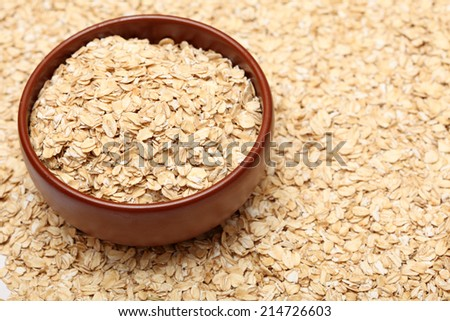 Oats in bowl. Oats background. Closeup. - stock photo