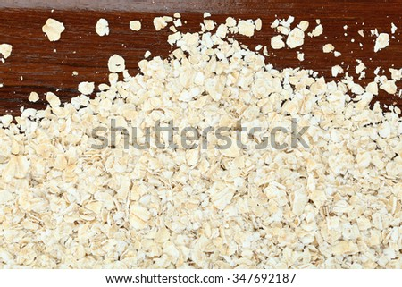 oats on wood background - stock photo