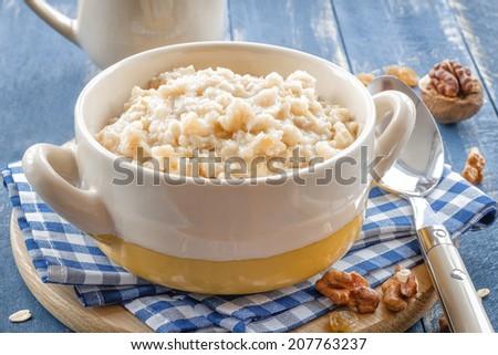 Oats porridge - stock photo