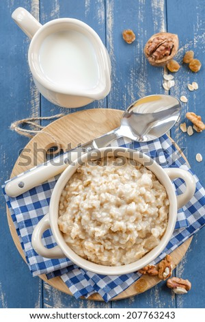 Oats porridge - stock photo