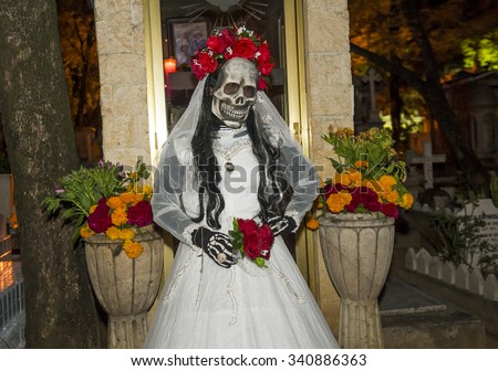 OAXACA , MEXICO - NOV 02 : A person with a costume on a cemetery in the Day of the Dead in Oaxaca, Mexico on November 02 2015. The Day of the Dead is one of the most popular holidays in Mexico - stock photo