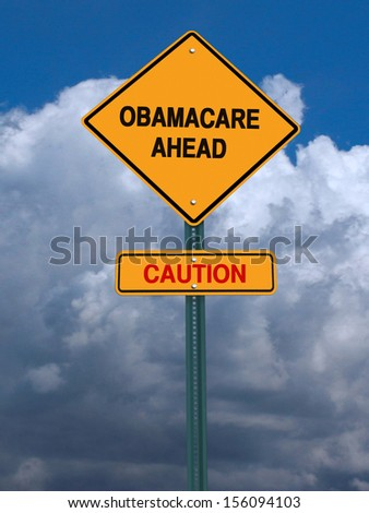 obamacare ahead caution conceptual directional post over dramatic blue sky - stock photo