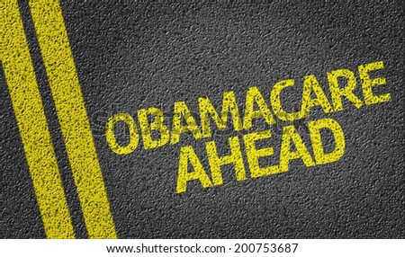 Obamacare Ahead written on the road - stock photo