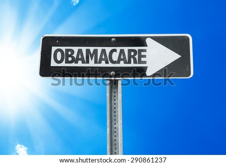 Obamacare direction sign with a beautiful day - stock photo