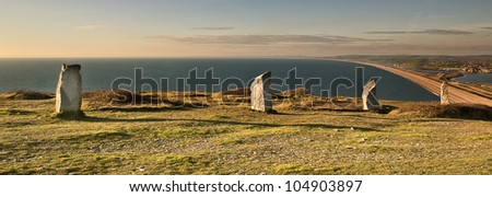 Obelisks' Sea View;  Four Obelisks' stand sentinel over the chesil atop the quarried cliffs of Portland. - stock photo