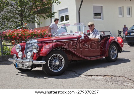 "OBERDIGISHEIM - JULY 28: Morgan MG Plus Four car on  ""Oldtimer meeting"" in Oberdigisheim, Germany on July 28, 2013. Around 4'500 ""Morgan +4"" was produced between 1950 and 1961. - stock photo"
