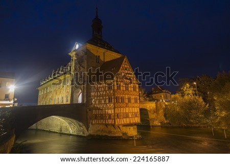 Obere bridge (brucke) and Altes Rathaus at night in Bamberg, Germany - stock photo