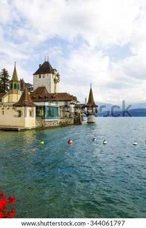 OBERHOFEN, SWITZERLAND - SEPTEMBER 08, 2015: Castle of Oberhofen dates back history to the 13th century. Branch museum of the Historic Museum of Berne opened to the public since 1954 - stock photo