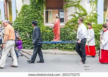 OBERROTWEIL, GERMANY - JUNE 29, 2014: Johannis procession in Oberrrotweil, Germany. The annual Johannis festival is dedicated to apostel Johannes and all people of the town take place. - stock photo