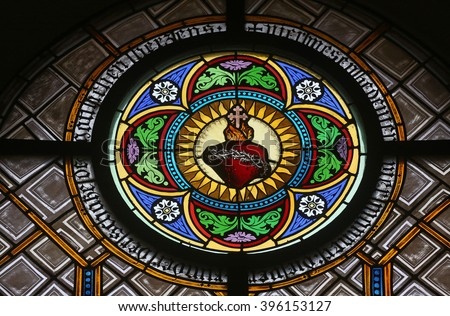 OBERSTAUFEN, GERMANY - OCTOBER 20: Sacred Heart of Jesus, stained glass window in the parish church of St. Peter and Paul in Oberstaufen, Germany on October 20, 2014. - stock photo