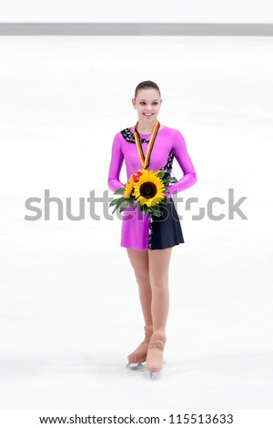OBERSTDORF - SEPT 28: Ladies silver medalist Adelina Sotnikova of Russia poses for photographs after medal ceremony at Nebelhorn Trophy for figure skating on September 28, 2012 in Oberstdorf, Germany - stock photo