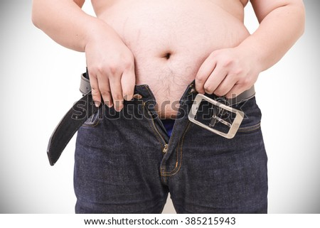 Obese men can't wearing pants - stock photo