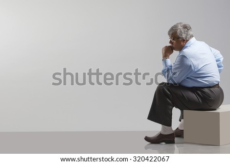 Obese old man thinking - stock photo