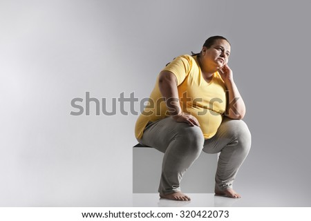 Obese woman thinking - stock photo