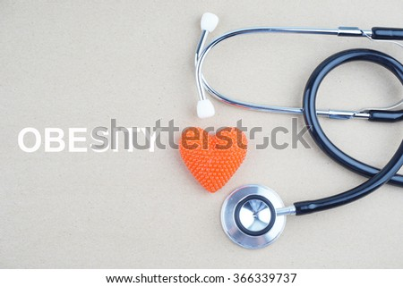 OBESITY concept with stethoscope and heart shape  - stock photo