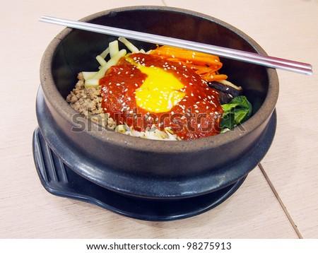 Obibimbap in a heated stone bowl, korean dishLYMPUS DIGITAL CAMERA - stock photo