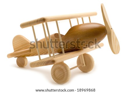 object on white - wooden toy airplane - stock photo