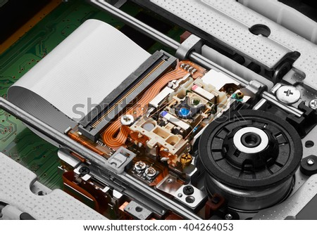 Objective lens and spindle assembly of a computer cd-rom drive, closeup - stock photo