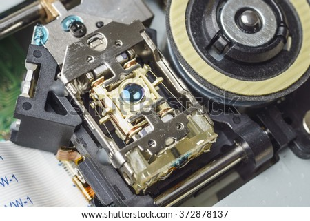 Objective lens assembly of a computer cd-rom drive, macro shot - stock photo