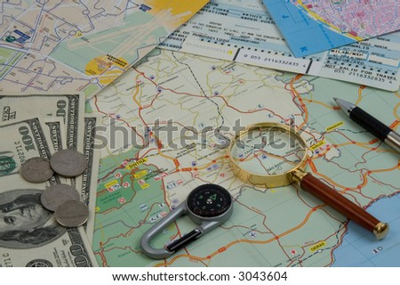 Objects for planning travel - a map, compass, a magnifier, money - stock photo