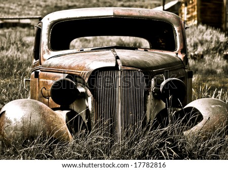 Objects in various stages of decay and aging, abandoned and forgotten - abandoned car. - stock photo