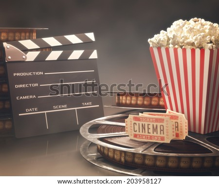 Objects related to the cinema on reflective surface. - stock photo